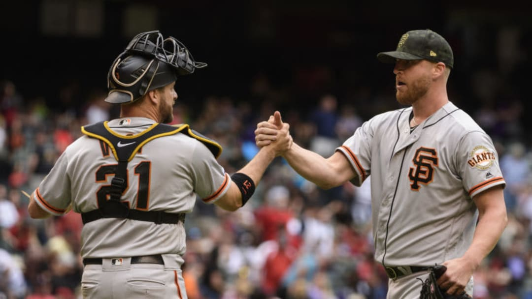PHOENIX, ARIZONA - MAY 19: Stephen Vogt #21 and Will Smith #13 of the San Francisco Giants celebrate after closing out the tenth inning of the MLB game against the Arizona Diamondbacks at Chase Field on May 19, 2019 in Phoenix, Arizona. The San Francisco Giants won 3-2. (Photo by Jennifer Stewart/Getty Images)