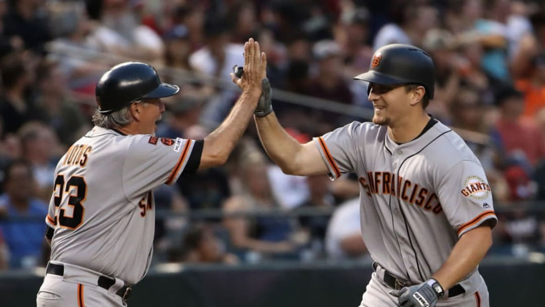 PHOENIX, ARIZONA - JUNE 21: Alex Dickerson #8 of the San Francisco Giants is congratulated by third base coach Ron Wotus #23 after hitting a grand-slam home run against the Arizona Diamondbacks during the third inning of the MLB game at Chase Field on June 21, 2019 in Phoenix, Arizona. (Photo by Christian Petersen/Getty Images)