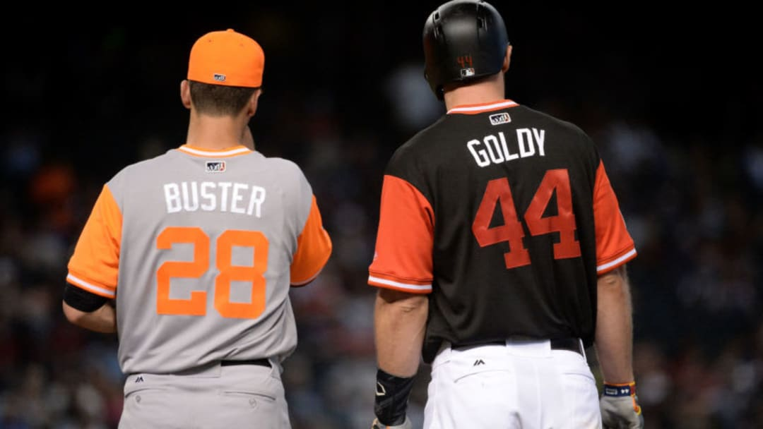 PHOENIX, AZ - AUGUST 27: Buster Posey #28 of the San Francisco Giants and Paul Goldschmidt #44 of the Arizona Diamondbacks each wearing nickname-bearing jerseys stand at first base in the fourth inning at Chase Field on August 27, 2017 in Phoenix, Arizona. (Photo by Jennifer Stewart/Getty Images)
