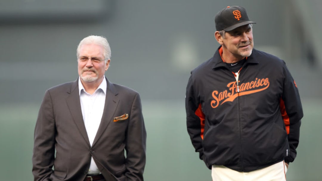 SAN FRANCISCO, CA - JUNE 09: General manager Brian Sabean and manager Bruce Bochy stand on the field before a ceremony for Edgar Renteria