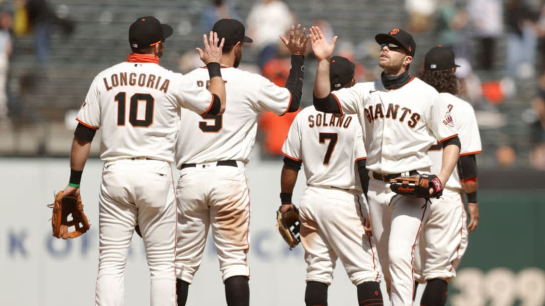 SAN FRANCISCO, CALIFORNIA - APRIL 14: Austin Slater #13 and Evan Longoria #10 of the San Francisco Giants congratulate one another after they beat the Cincinnati Reds at Oracle Park on April 14, 2021 in San Francisco, California. (Photo by Ezra Shaw/Getty Images)