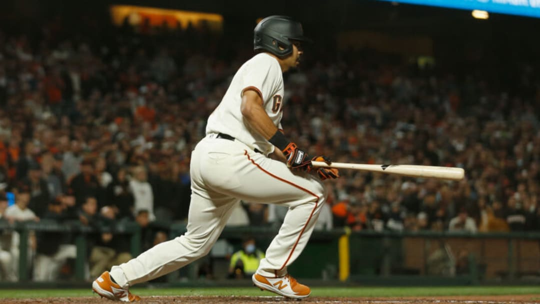 SAN FRANCISCO, CALIFORNIA - SEPTEMBER 30: LaMonte Wade Jr. #31 of the San Francisco Giants hits a walk-off RBI single in the bottom of the ninth inning to beat the Arizona Diamondbacks at Oracle Park on September 30, 2021 in San Francisco, California. (Photo by Lachlan Cunningham/Getty Images)