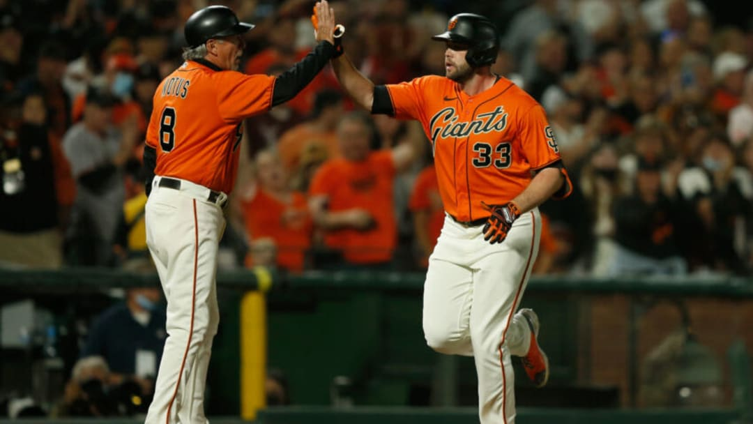 SAN FRANCISCO, CALIFORNIA - OCTOBER 01: Darin Ruf #33 of the San Francisco Giants celebrates with third base coach Ron Wotus #8 after hitting a solo home run in the bottom of the first inning against the San Diego Padres at Oracle Park on October 01, 2021 in San Francisco, California. (Photo by Lachlan Cunningham/Getty Images)