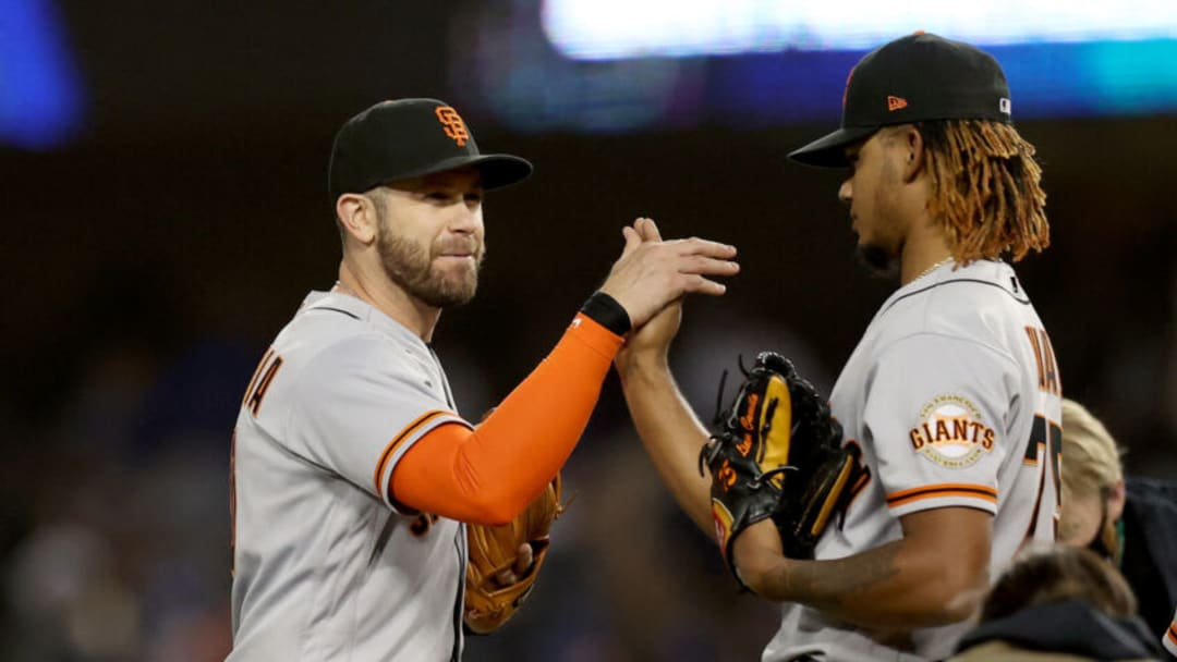 LOS ANGELES, CALIFORNIA - OCTOBER 11: Evan Longoria #10 and Camilo Doval #75 of the SF Giants celebrate after beating the Los Angeles Dodgers 1-0 in game 3 of the National League Division Series at Dodger Stadium on October 11, 2021 in Los Angeles, California. (Photo by Ronald Martinez/Getty Images)