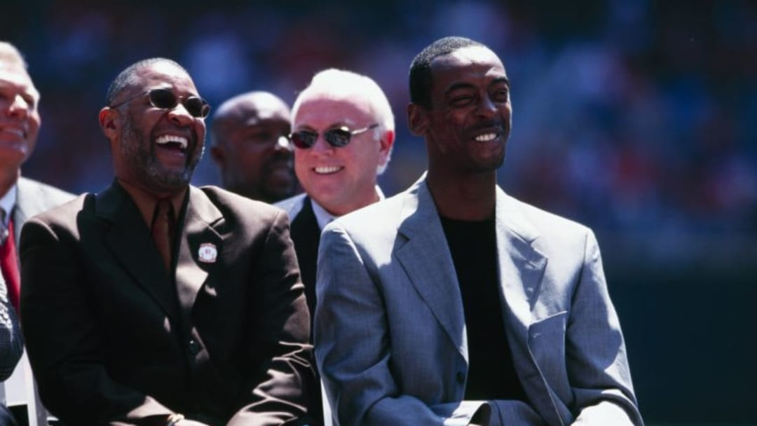 ST. LOUIS - APRIL 9: Former St. Louis Cardinals players Ozzie Smith and Willie McGee laugh during Willie McGee Day before the game against the Milwaukee Brewers at Busch Stadium on April 9, 2000 in St. Louis, Missouri. (Photo by Elsa/Getty Images)