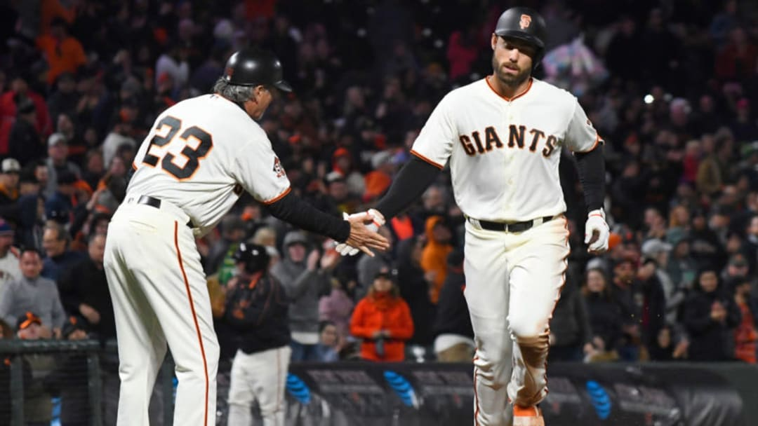 SAN FRANCISCO, CA - APRIL 24: Mac Williamson #51 of the San Francisco Giants is congratulated by third base coach Ron Wotus #23 on his solo home run against the Washington Nationals in the bottom of the six inning at AT&T Park on April 24, 2018 in San Francisco, California. (Photo by Thearon W. Henderson/Getty Images)