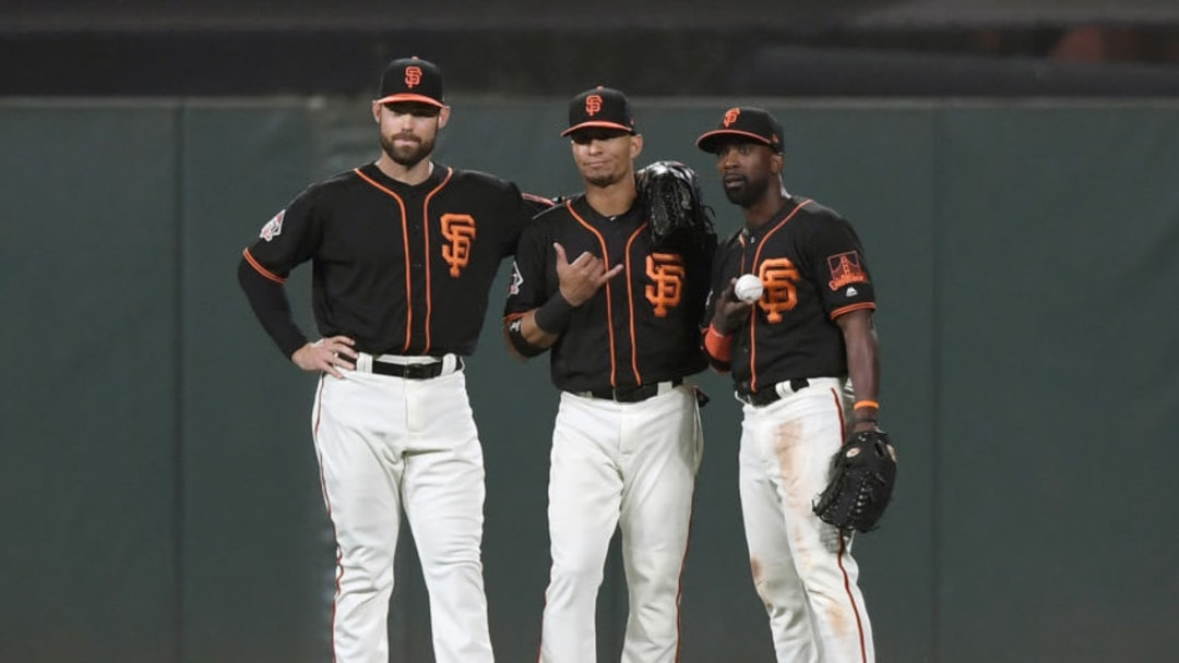 SAN FRANCISCO, CA - JUNE 02: (L-R) Mac Williamson #51, Gorkys Hernandez #7 and Andrew McCutchen #22 of the San Francisco Giants celebrates defeating the Philadelphia Phillies 2-0 at AT&T Park on June 2, 2018 in San Francisco, California. (Photo by Thearon W. Henderson/Getty Images)