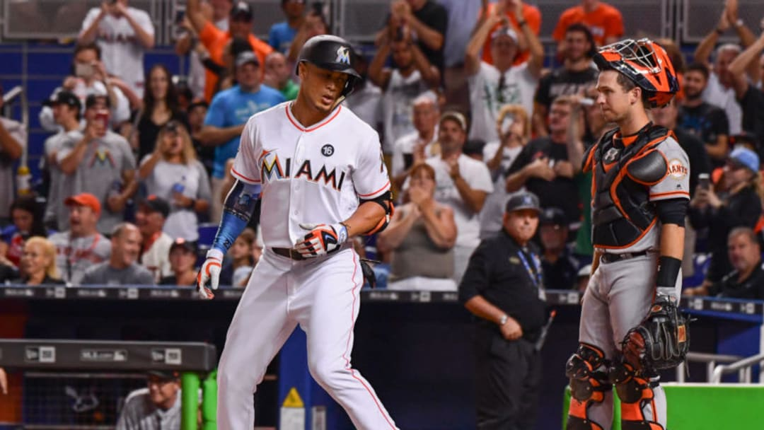 MIAMI, FL - AUGUST 15: Giancarlo Stanton #27 of the Miami Marlins hits a homerun in the third inning during the game between the Miami Marlins and the San Francisco Giants at Marlins Park on August 15, 2017 in Miami, Florida. (Photo by Mark Brown/Getty Images)