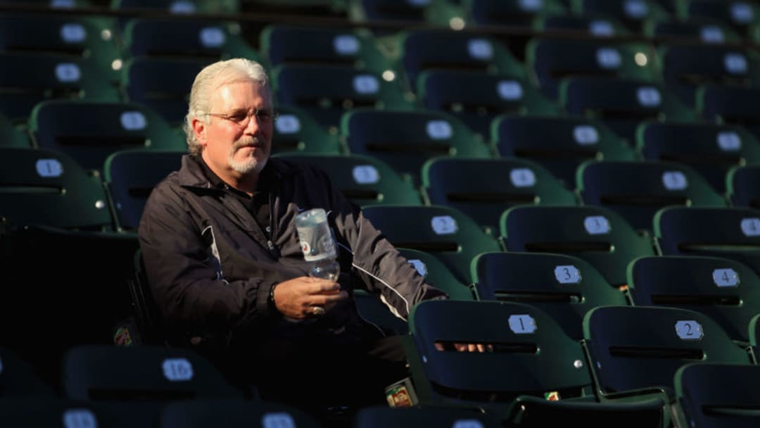 SAN FRANCISCO - OCTOBER 13: San Francisco Giants general manager Brian Sabean sits in the stands during a workout session in preparation for the National League Championship Series at AT