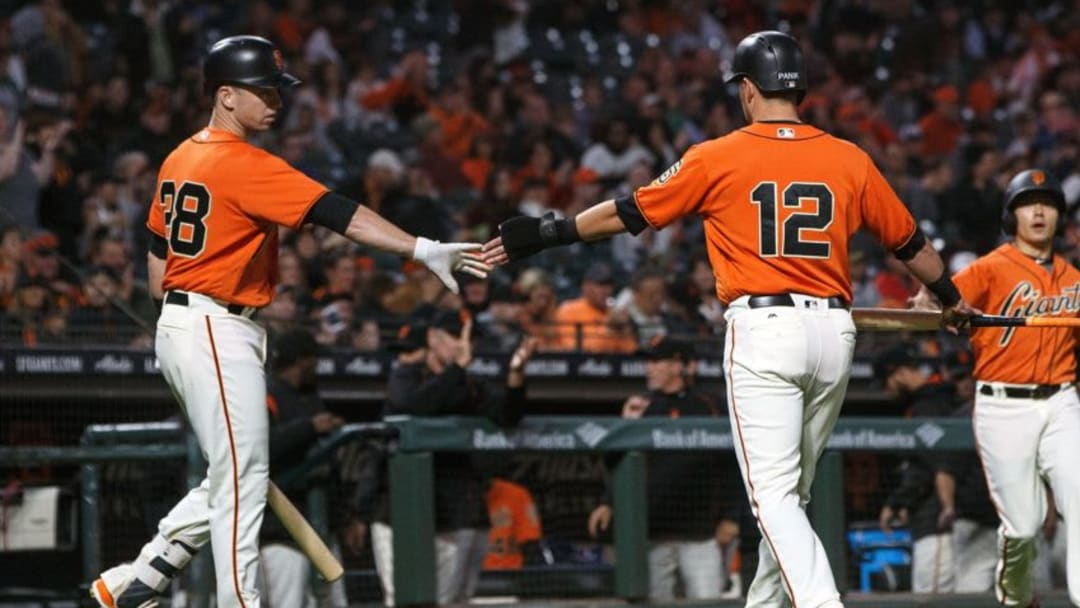 SAN FRANCISCO, CA - SEPTEMBER 15: Joe Panik #12 of the San Francisco Giants is congratulated by Buster Posey #28 after scoring a run against the Arizona Diamondbacks during the first inning at AT&T Park on September 15, 2017 in San Francisco, California. (Photo by Jason O. Watson/Getty Images)