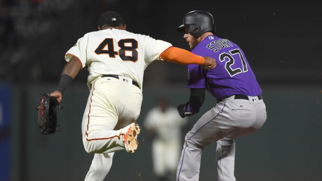 SAN FRANCISCO, CA - SEPTEMBER 19: Trevor Story #27 of the Colorado Rockies gets caught in a rundown and tagged out by Pablo Sandoval #48 of the San Francisco Giants in the top of the fourth inning at AT&T Park on September 19, 2017 in San Francisco, California. (Photo by Thearon W. Henderson/Getty Images)