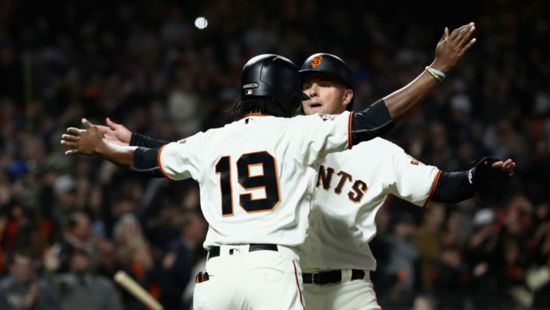 SAN FRANCISCO, CA - JUNE 04: Alen Hanson #19 and Joe Panik #12 of the San Francisco Giants celebrate after they scored on a hit by Buster Posey #28 of the San Francisco Giants in the fourth inning against the Arizona Diamondbacks at AT&T Park on June 4, 2018 in San Francisco, California. (Photo by Ezra Shaw/Getty Images)