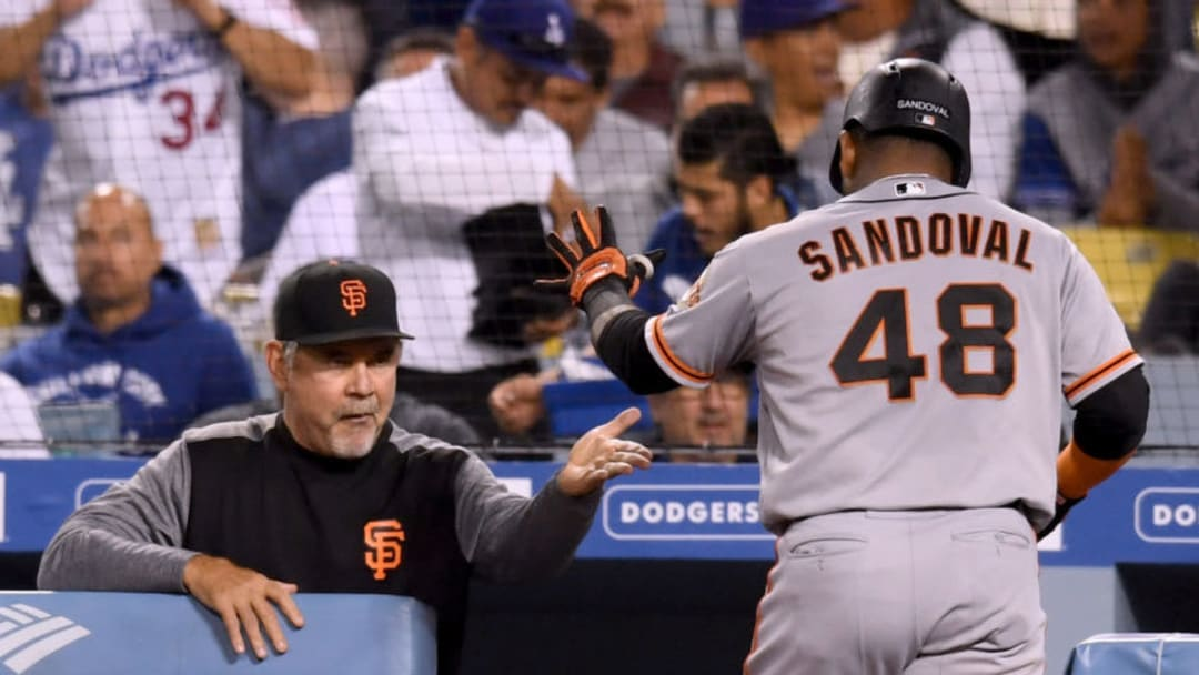 LOS ANGELES, CA - JUNE 15: Bruce Bochy #15 of the San Francisco Giants celebrates a two run homerun of Pablo Sandoval #48 to trail 2-3 to the Los Angeles Dodgers during the seventh inning at Dodger Stadium on June 15, 2018 in Los Angeles, California. (Photo by Harry How/Getty Images)