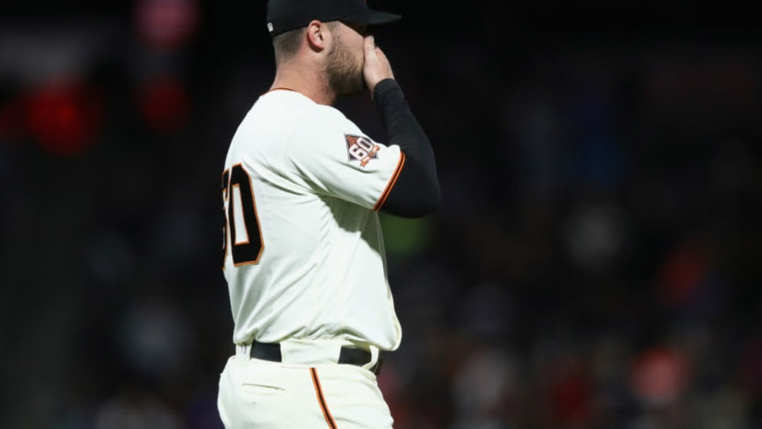 SAN FRANCISCO, CA - JUNE 18: Hunter Strickland #60 of the San Francisco Giants reacts after giving up a hit to Miguel Rojas #19 of the Miami Marlins that scored the go-ahead run in the bottom of the ninth inning against the San Francisco Giants at AT&T Park on June 18, 2018 in San Francisco, California. (Photo by Ezra Shaw/Getty Images)
