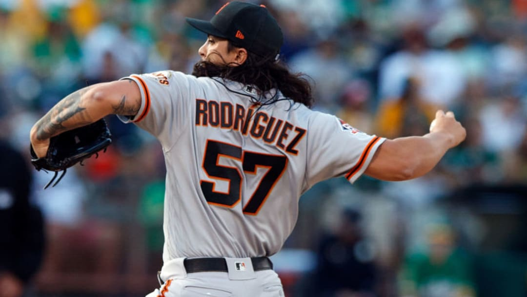 OAKLAND, CA - JULY 20: Dereck Rodriguez #57 of the San Francisco Giants pitches against the Oakland Athletics during the first inning at the Oakland Coliseum on July 20, 2018 in Oakland, California. (Photo by Jason O. Watson/Getty Images)