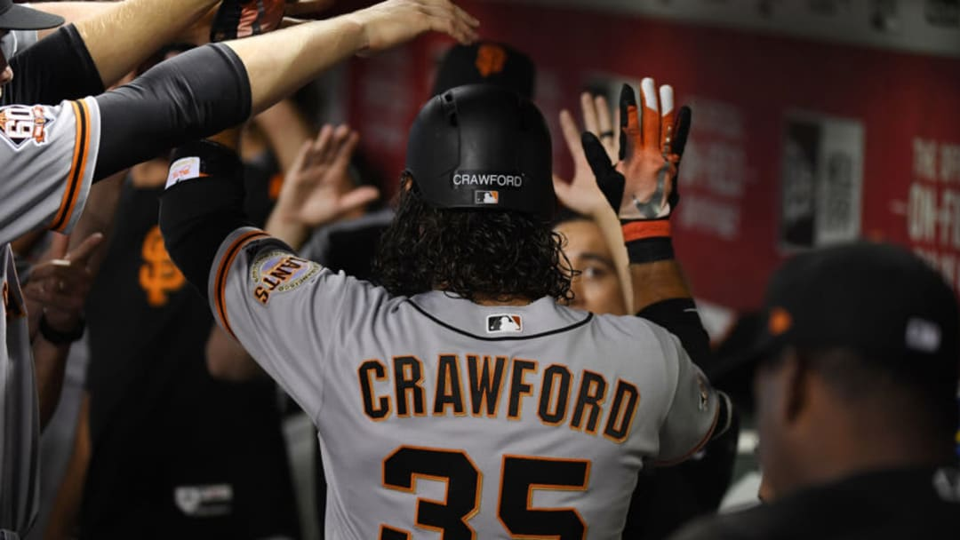 PHOENIX, AZ - JUNE 30: Brandon Crawford #35 of the San Francisco Giants celebrates with teammates in the dugout after hitting a solo home run off of Shelby Miller #26 of the Arizona Diamondbacks during the second inning at Chase Field on June 30, 2018 in Phoenix, Arizona. (Photo by Norm Hall/Getty Images)