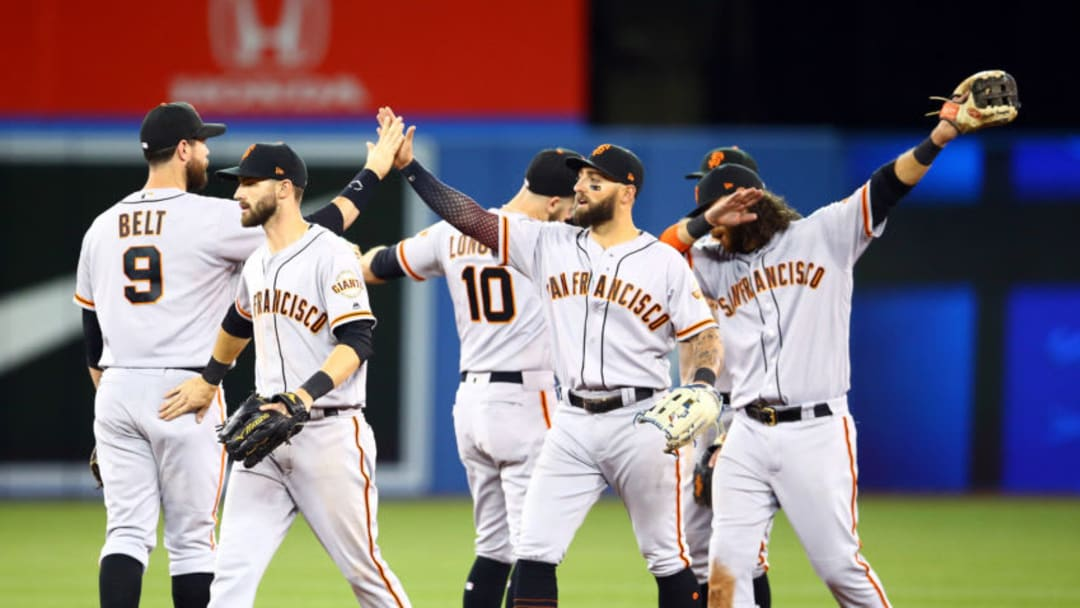 TORONTO, ON - APRIL 24: Kevin Pillar #1 (C) of the San Francisco Giants and teammates celebrate following victory over the Toronto Blue Jays in a MLB game at Rogers Centre on April 24, 2019 in Toronto, Canada. (Photo by Vaughn Ridley/Getty Images)
