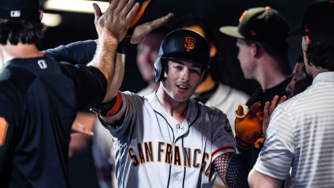 DENVER, CO - JULY 16: Mike Yastrzemski #5 of the San Francisco Giants is congratulated in the dugout after hitting a solo home run in the ninth inning against the Colorado Rockies at Coors Field on July 16, 2019 in Denver, Colorado. (Photo by Dustin Bradford/Getty Images)