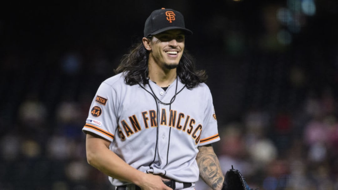 PHOENIX, ARIZONA - AUGUST 15: Dereck Rodriguez #57 of the San Francisco Giants smiles after a pitche during the MLB game against the Arizona Diamondbacks at Chase Field on August 15, 2019 in Phoenix, Arizona. (Photo by Jennifer Stewart/Getty Images)