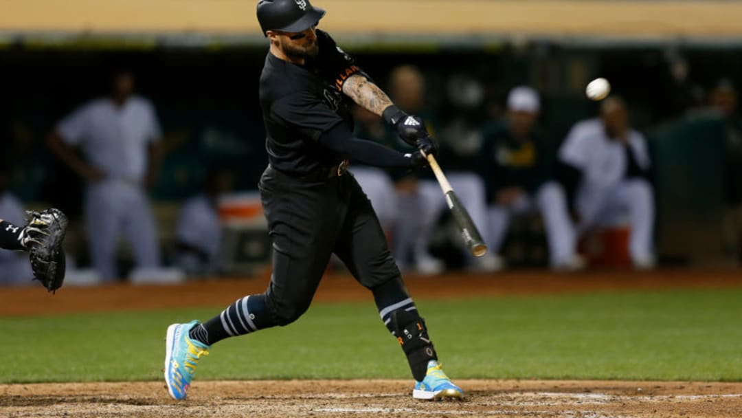 OAKLAND, CALIFORNIA - AUGUST 24: Kevin Pillar #1 of the San Francisco Giants hits a two-run double in the top of the eighth inning against the Oakland Athletics at Ring Central Coliseum on August 24, 2019 in Oakland, California. Teams are wearing special color schemed uniforms with players choosing nicknames to display for Players' Weekend. (Photo by Lachlan Cunningham/Getty Images)
