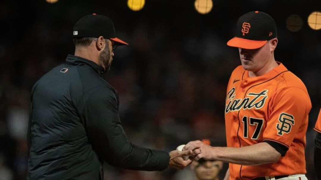 SAN FRANCISCO, CALIFORNIA - AUGUST 13: Jake McGee #17 of the San Francisco Giants is relieved by Gabe Kapler #19 during the ninth inning at Oracle Park on August 13, 2021 in San Francisco, California. The San Francisco Giants defeated the Colorado Rockies 5-4. (Photo by Jason O. Watson/Getty Images)