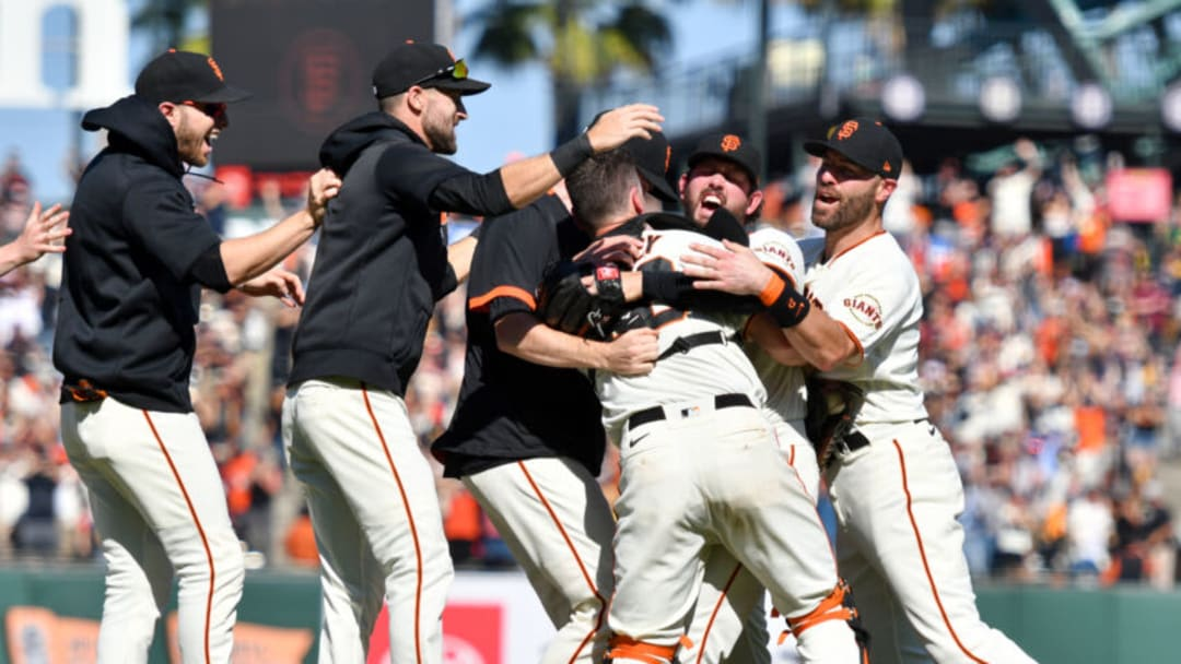 SAN FRANCISCO, CALIFORNIA - OCTOBER 03: The San Francisco Giants celebrate as they clinch NL West after their game against the San Diego Padres at Oracle Park on October 03, 2021 in San Francisco, California. (Photo by Brandon Vallance/Getty Images)