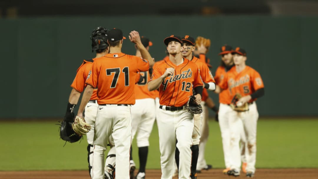 SAN FRANCISCO, CALIFORNIA - AUGUST 21: San Francisco Giants players celebrate after a win against the Arizona Diamondbacks at Oracle Park on August 21, 2020 in San Francisco, California. (Photo by Lachlan Cunningham/Getty Images)