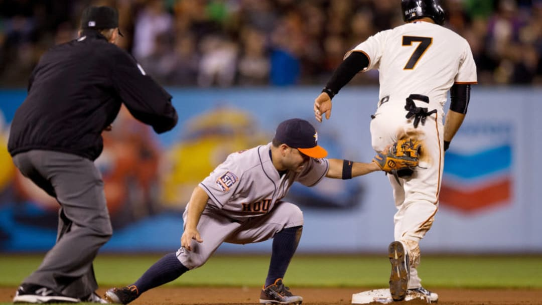 SAN FRANCISCO, CA - AUGUST 11: Gregor Blanco #7 of the San Francisco Giants steals second base ahead of a tag from Jose Altuve #27 of the Houston Astros during the seventh inning at AT&T Park on August 11, 2015 in San Francisco, California. The San Francisco Giants defeated the Houston Astros 3-1. (Photo by Jason O. Watson/Getty Images)