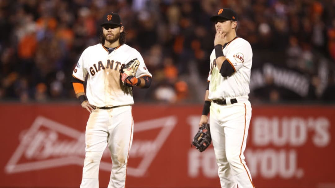 SAN FRANCISCO, CA - OCTOBER 11: Brandon Crawford #35 and Joe Panik #12 of the San Francisco Giants stand on the field during a pitching change in the ninth inning of Game Four of their National League Division Series at AT&T Park on October 11, 2016 in San Francisco, California. (Photo by Ezra Shaw/Getty Images)