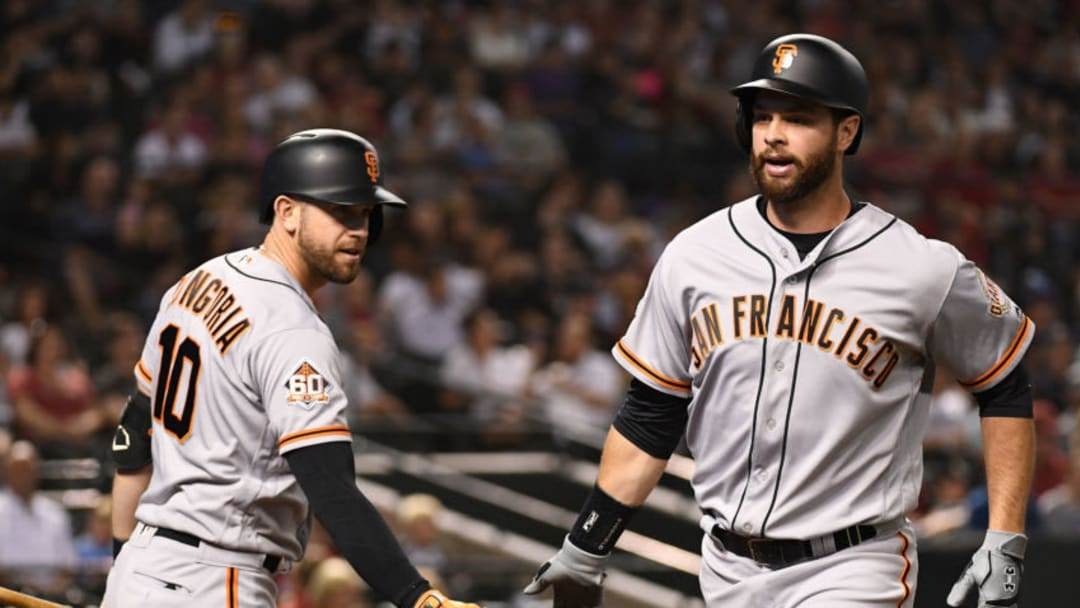 PHOENIX, AZ - APRIL 19: Brandon Belt #9 of the San Francisco Giants is congratulated by Evan Longoria #10 after hitting a solo home run in the second inning of the MLB game against the Arizona Diamondbacks at Chase Field on April 19, 2018 in Phoenix, Arizona. (Photo by Jennifer Stewart/Getty Images)