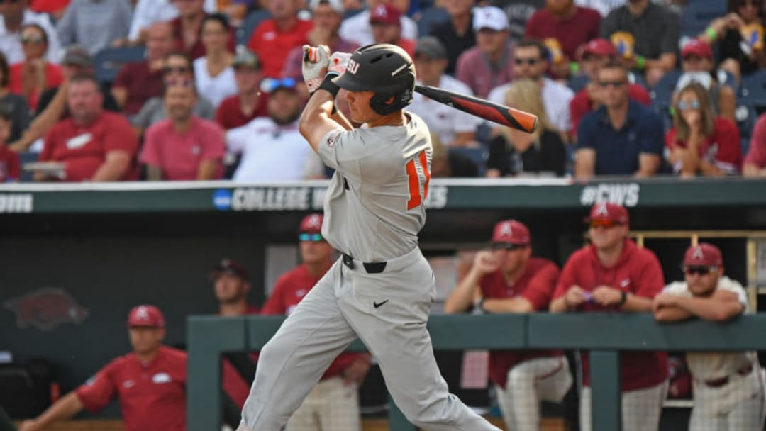 Omaha, NE - JUNE 28: Outfielder Trevor Larnach #11 of the Oregon State Beavers singles in the first inning against the Arkansas Razorbacks during game three of the College World Series Championship Series on June 28, 2018 at TD Ameritrade Park in Omaha, Nebraska. (Photo by Peter Aiken/Getty Images)