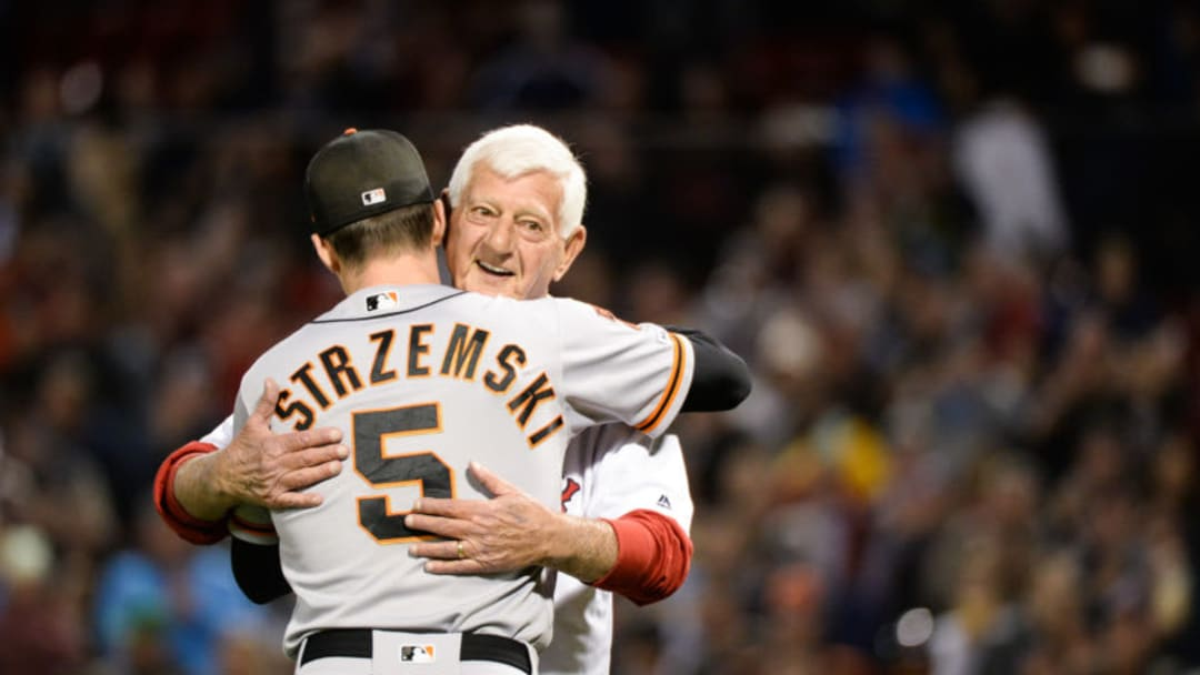 Baseball Hall of Famer Carl Yastrzemski hugs his grandson, Mike Yastrzemski of the SF Giants prior to throwing out a ceremonial first pitch. (Photo by Kathryn Riley/Getty Images)