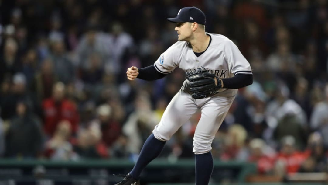 BOSTON, MA - OCTOBER 05: David Robertson #30 of the New York Yankees delivers a pitch in the eighth inning against the Boston Red Sox in Game One of the American League Division Series at Fenway Park on October 5, 2018 in Boston, Massachusetts. (Photo by Elsa/Getty Images)