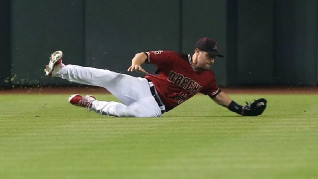 PHOENIX, AZ - APRIL 22: A.J. Pollock #11 of the Arizona Diamondbacks makes a sliding catch on a ball hit by Jose Pirela #2 of the San Diego Padres during the fourth inning of an MLB game at Chase Field on April 22, 2018 in Phoenix, Arizona. (Photo by Ralph Freso/Getty Images)