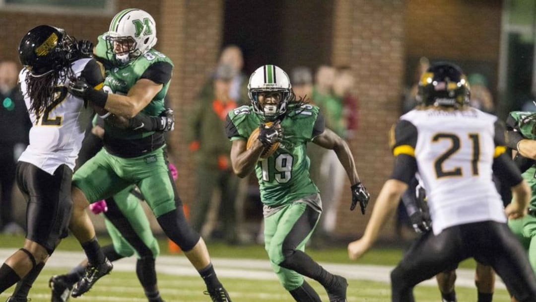 Oct 9, 2015; Huntington, WV, USA; Marshall Thundering Herd wide receiver Deandre Reaves (19) returns a kickoff during the second quarter against the Southern Miss Golden Eagles at Joan C. Edwards Stadium. Mandatory Credit: Ben Queen-USA TODAY Sports