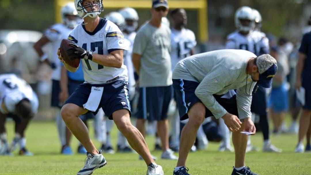Jul 30, 2016; San Diego, CA, USA; San Diego Chargers quarterback Philip Rivers (17) drops back to pass during training camp at Chargers Park. Mandatory Credit: Jake Roth-USA TODAY Sports