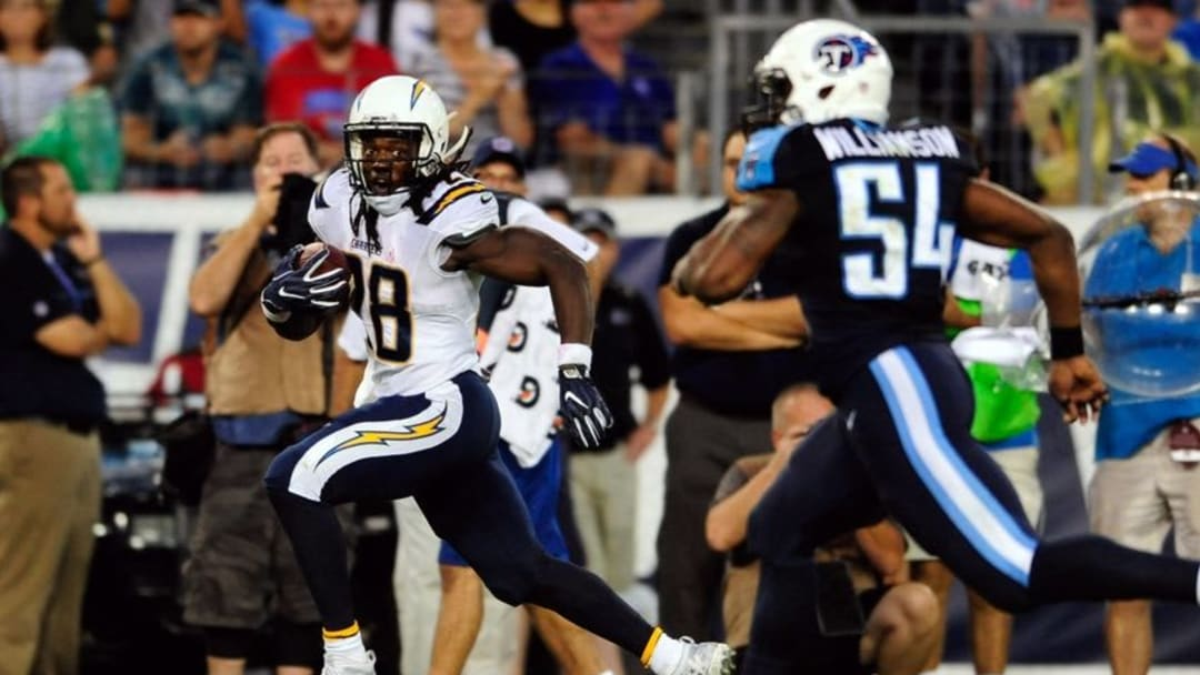 Aug 13, 2016; Nashville, TN, USA; San Diego Chargers running back Melvin Gordon (28) carries the ball away from Tennessee Titans inside linebacker Avery Williamson (54) during the first half at Nissan Stadium. Mandatory Credit: Joshua Lindsey-USA TODAY Sports