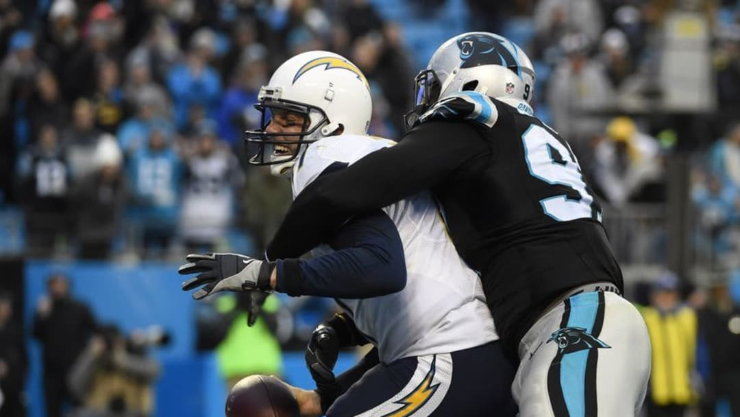 Dec 11, 2016; Charlotte, NC, USA; San Diego Chargers quarterback Philip Rivers (17) is sacked for a safety by Carolina Panthers defensive end Mario Addison (97) in the fourth quarter. The Panthers defeated the Chargers 28-16 at Bank of America Stadium. Mandatory Credit: Bob Donnan-USA TODAY Sports