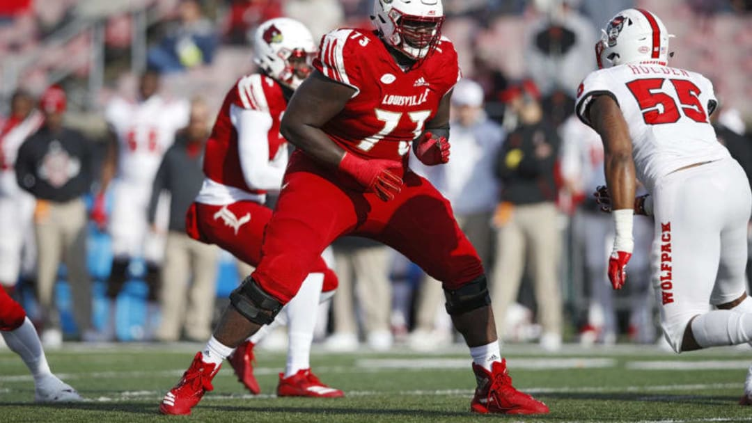 LOUISVILLE, KY - NOVEMBER 17: Mekhi Becton #73 of the Louisville Cardinals blocks against the North Carolina State Wolfpack during the game at Cardinal Stadium on November 17, 2018 in Louisville, Kentucky. (Photo by Joe Robbins/Getty Images)