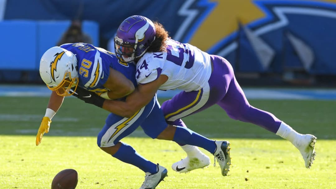CARSON, CA - DECEMBER 15: Middle linebacker Eric Kendricks #54 of the Minnesota Vikings forces a fumble by running back Austin Ekeler #30 of the Los Angeles Chargers allowing defensive end Ifeadi Odenigbo #95 of the Minnesota Vikings to grab the ball and run for a touchdown in the second quarter of the game at Dignity Health Sports Park on December 15, 2019 in Carson, California. (Photo by Jayne Kamin-Oncea/Getty Images)