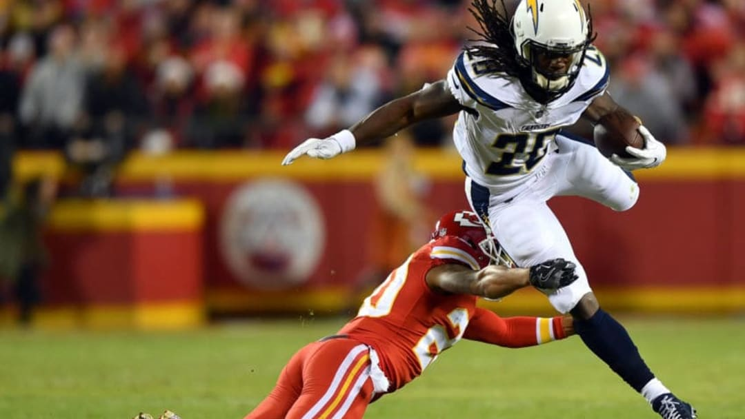 KANSAS CITY, MO - DECEMBER 16: Running back Melvin Gordon #28 of the Los Angeles Chargers carries the ball as cornerback Steven Nelson #20 of the Kansas City Chiefs defends during the game at Arrowhead Stadium on December 16, 2017 in Kansas City, Missouri. (Photo by Peter Aiken/Getty Images)