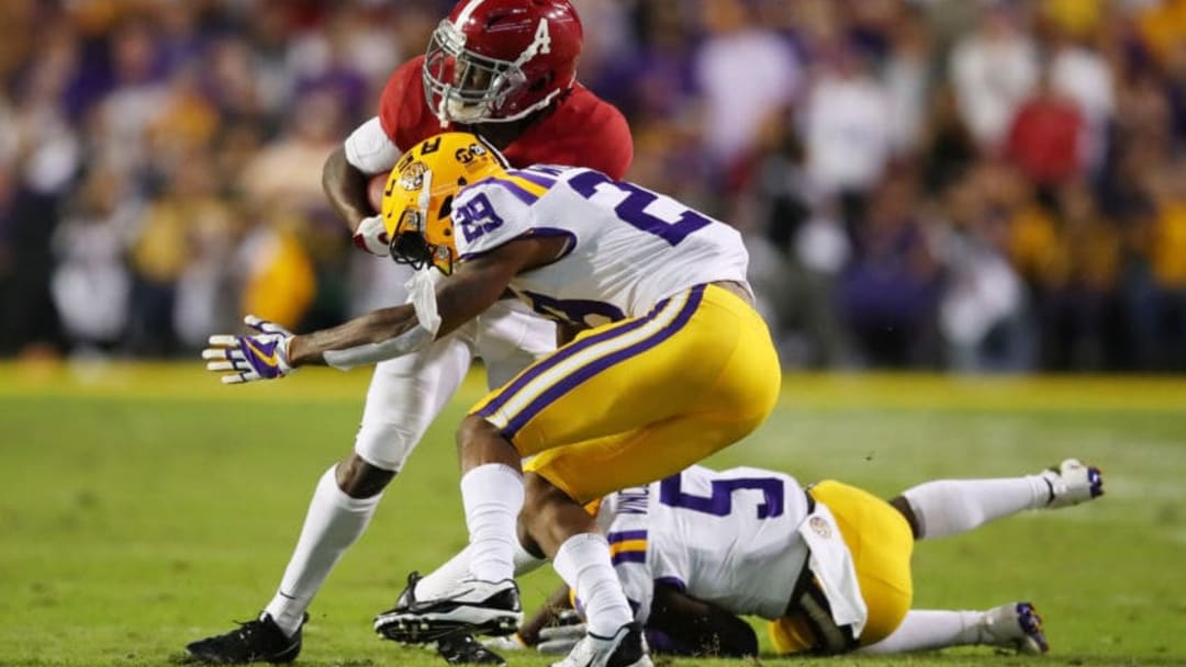 BATON ROUGE, LOUISIANA - NOVEMBER 03: Jerry Jeudy #4 of the Alabama Crimson Tide tries to avoid the tackle of Greedy Williams #29 of the LSU Tigers in the second quarter of their game at Tiger Stadium on November 03, 2018 in Baton Rouge, Louisiana. (Photo by Gregory Shamus/Getty Images)