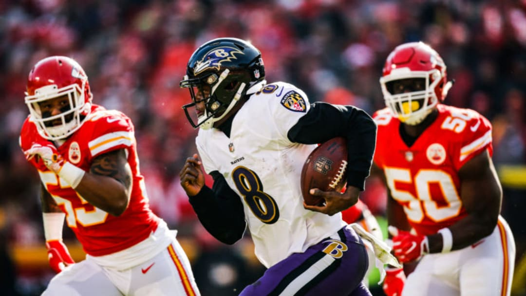 KANSAS CITY, MO - DECEMBER 9: Lamar Jackson #8 of the Baltimore Ravens runs out of the pocket with Anthony Hitchens #53 and teammate Justin Houston #50 of the Kansas City Chiefs in pursuit during the second quarter of the game at Arrowhead Stadium on December 9, 2018 in Kansas City, Missouri. (Photo by David Eulitt/Getty Images)