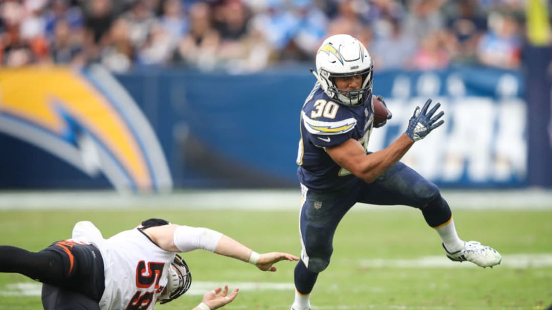 CARSON, CA - DECEMBER 09: Running back Austin Ekeler #30 of the Los Angeles Chargers makes a run play in front of outside linebacker Nick Vigil #59 of the Cincinnati Bengals in the third quarter at StubHub Center on December 9, 2018 in Carson, California. (Photo by Sean M. Haffey/Getty Images)
