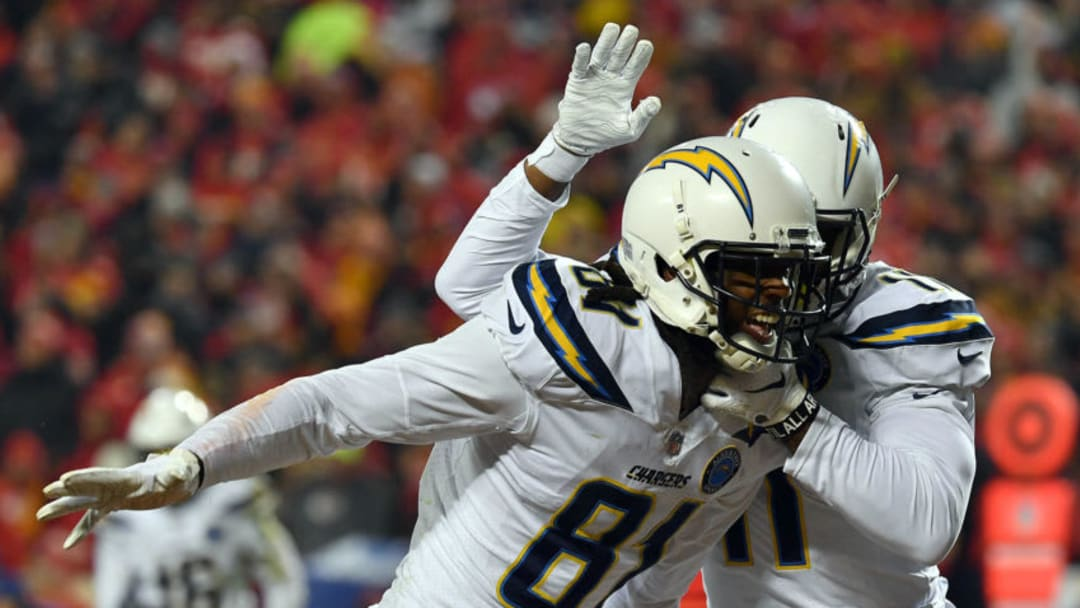 KANSAS CITY, MISSOURI - DECEMBER 13: Wide receiver Mike Williams #81 and wide receiver Geremy Davis #11 of the Los Angeles Chargers celebrate after a touchdown during the game against the Kansas City Chiefs at Arrowhead Stadium on December 13, 2018 in Kansas City, Missouri. (Photo by Peter Aiken/Getty Images)