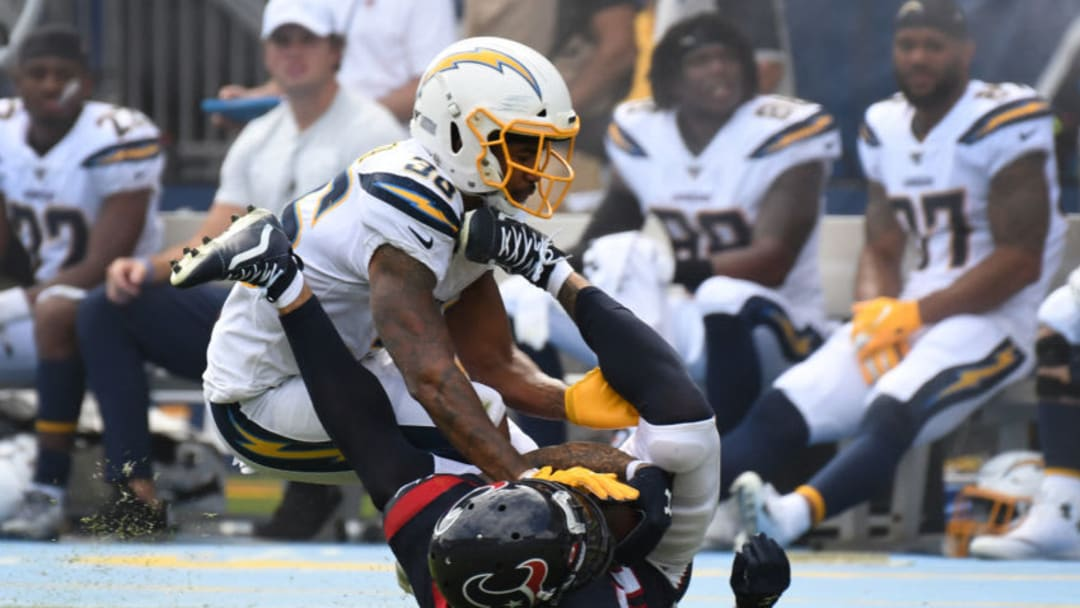 CARSON, CALIFORNIA - SEPTEMBER 22: Wide receiver Kenny Stills #12 of the Houston Texans and defensive back Roderic Teamer #36 of the Los Angeles Chargers fall after a pass play at Dignity Health Sports Park on September 22, 2019 in Carson, California. (Photo by Meg Oliphant/Getty Images)