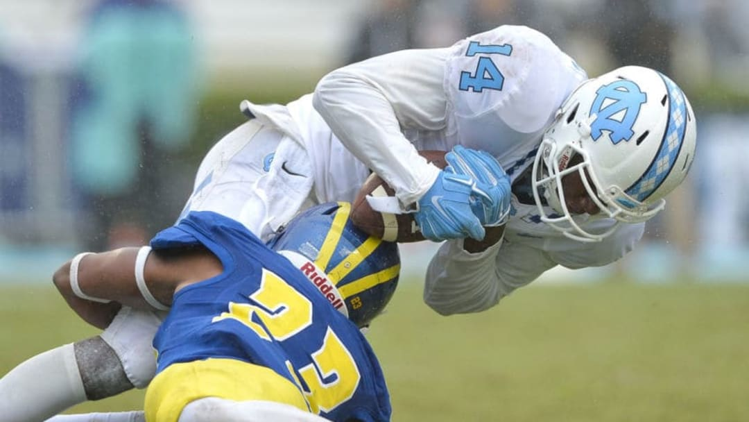 CHAPEL HILL, NC - SEPTEMBER 26: Nasir Adderley #23 of the Delaware Fightin Blue Hens tackles Quinshad Davis #14 of the North Carolina Tar Heels during their game at Kenan Stadium on September 26, 2015 in Chapel Hill, North Carolina. North Carolina won 41-14. (Photo by Grant Halverson/Getty Images)