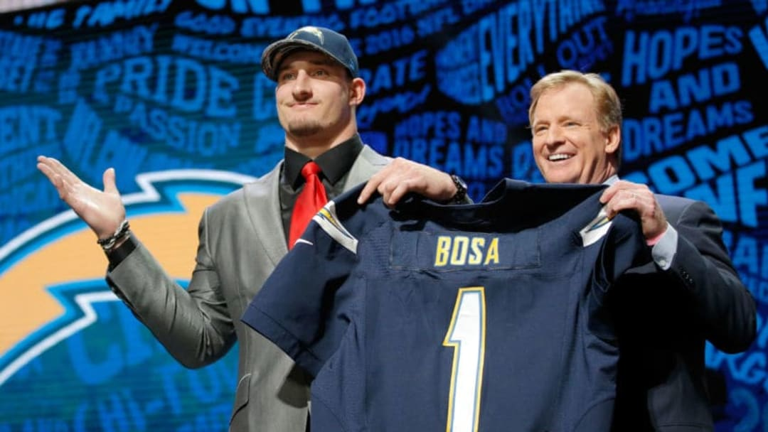 CHICAGO, IL - APRIL 28: (L-R) Joey Bosa of Ohio State holds up a jersey with NFL Commissioner Roger Goodell after being picked