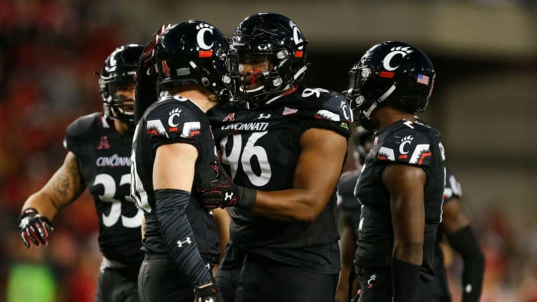 CINCINNATI, OH - SEPTEMBER 30: Cortez Broughton #96 celebrates with Carter Jacobs #20 of the Cincinnati Bearcats after a tackle against the Marshall Thundering Herd during the first half at Nippert Stadium on September 30, 2017 in Cincinnati, Ohio. (Photo by Michael Reaves/Getty Images)