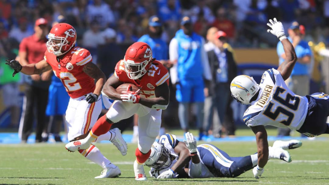 CARSON, CA - SEPTEMBER 24: Kareem Hunt #27 of the Kansas City Chiefs avoids the tackle during the game against the Los Angeles Chargers at the StubHub Center on September 24, 2017 in Carson, California. (Photo by Sean M. Haffey/Getty Images)